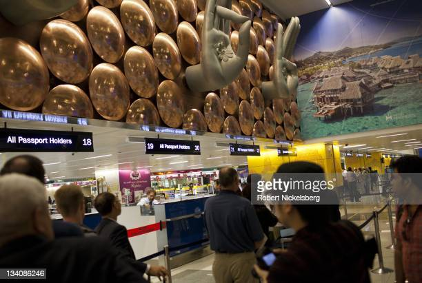 International travelers approach Indian passport and immigration counters October 9 2011 at Terminal 3 of the Indira Gandhi International Airport in...