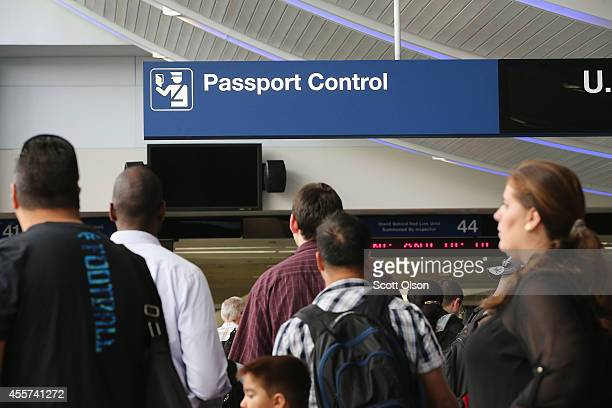 International travelers wait to have their passports checked at O'Hare International Airport on September 19 2014 in Chicago Illinois OHare is the...