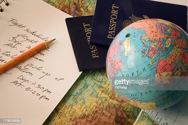 International Vacation Travel Planning with Passport, Globe, Map and Schedule