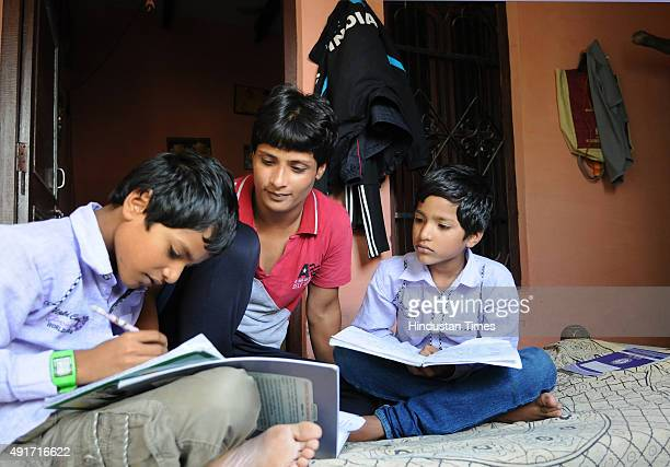 International wrestler Neetu watch her twin sons Prince and Ayush during study at her village Bedwa on September 24 2015 in Rohtak India 21yearold...