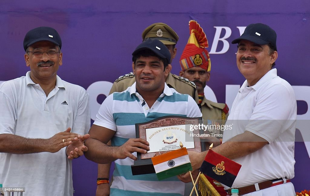 International wrestler Sushil Kumar being facilitated by DG BSF KK Sharma during the cycle rally to spread the awareness about Drug Abuse and illicit Trafficking on the occasion of International Day Against Drug Abuse and Illicit Trafficking at Jawahar Lal Nehru Stadium on June 26, 2016 in New Delhi, India.