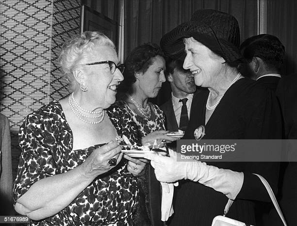 Internationally successful crime writers Agatha Christie and Ngaio Marsh meet at a party at the Savoy Hotel June 1960