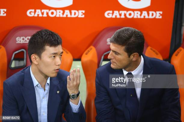 FC Internazionale board member Steven Zhang talks with the Vice President of FC Internazionale Javier Zanetti during the Serie A match between AS...