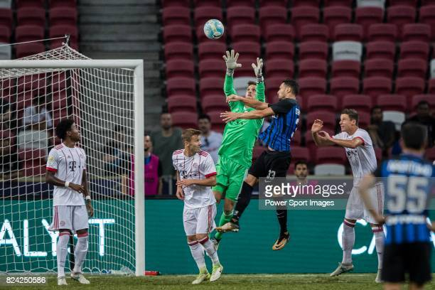 Internazionale Defender Danilo D'u2019Ambrosio fights for the ball with Bayern Munich Goalkeeper Sven Ulreich during the International Champions Cup...