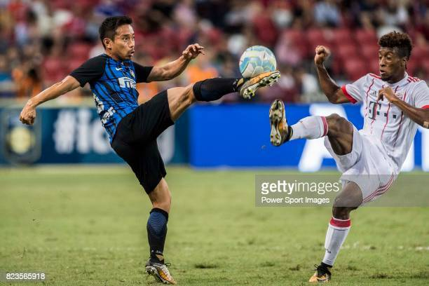 Internazionale Defender Yuto Nagatomo trips up with Bayern Munich Forward Kingsley Coman during the International Champions Cup match between FC...