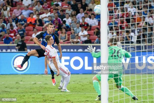 Internazionale Forward Ivan Perisic attempts a kick while being defended by Bayern Munich Goalkeeper Sven Ulreich during the International Champions...