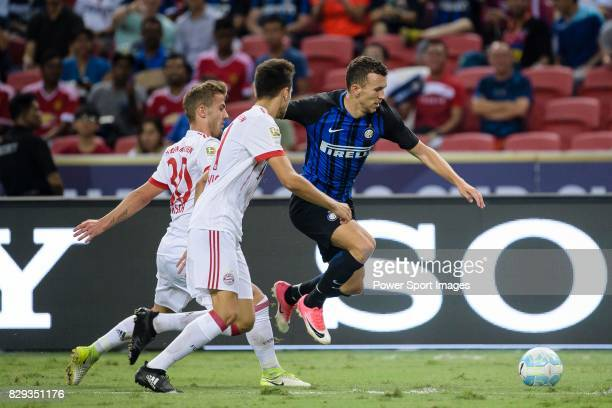 Internazionale Forward Ivan Perisic fights for the ball with Bayern Munich Midfielder Niklas Dorsch during the International Champions Cup match...