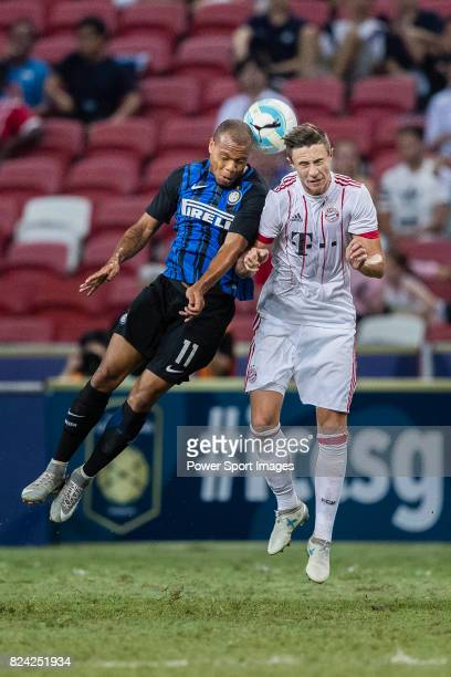 Internazionale Forward Jonathan Biabiany fights for the ball with Bayern Munich Defender Marco Friedl during the International Champions Cup match...
