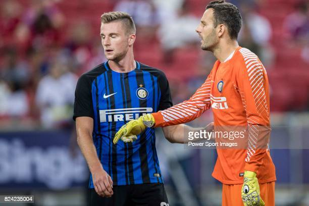 Internazionale Goalkeeper Samir Handanovic talks to FC Internazionale Defender Milan Skriniar during the International Champions Cup match between FC...