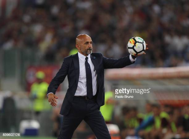 Internazionale head coach Luciano Spalletti takes the ball during the Serie A match between AS Roma and FC Internazionale on August 26 2017 in Rome...