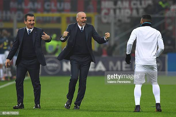 Internazionale head coach Stefano Pioli celebrates after his player Ivan Perisic scored the equalizer goal during the Serie A match between AC Milan...