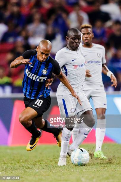 Internazionale Midfielder Joao Mario trips up with Chelsea Midfielder N'Golo Kante during the International Champions Cup 2017 match between FC...