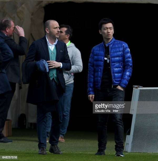 Internazionale Milano board member Steven Zhang Kangyang and Sporting Director Piero Ausilio chat prior to the Serie A match between Cagliari Calcio...