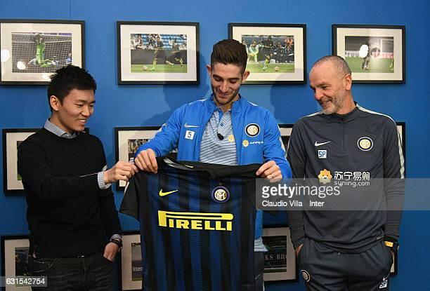 FC Internazionale Milano board member Steven Zhang Kangyang Roberto Gagliardini and head coach FC Internazionale Stefano Pioli pose for a photo after...