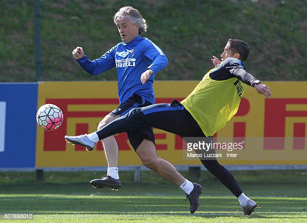 Internazionale Milano coach Roberto Mancini competes with assistant manager coach Sylvinho during the FC Internazionale training session at the...