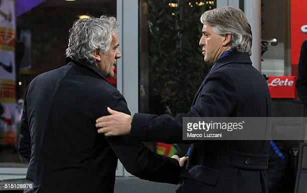 Internazionale Milano coach Roberto Mancini shakes hands with Bologna FC coach Roberto Donadoni before the Serie A match between FC Internazionale...