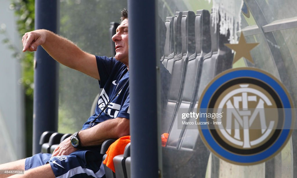 FC Internazionale Milano coach <a gi-track='captionPersonalityLinkClicked' href=/galleries/search?phrase=Walter+Mazzarri&family=editorial&specificpeople=5314636 ng-click='$event.stopPropagation()'>Walter Mazzarri</a> gestures during FC Internazionale Training Session at the club's training ground on August 29, 2014 in Appiano Gentile Como, Italy.