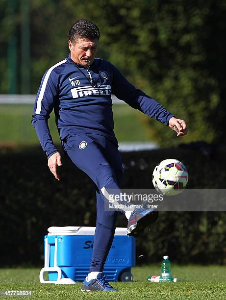 Internazionale Milano coach Walter Mazzarri kicks a ball during FC Internazionale training session at the club's training ground on October 24 2014...