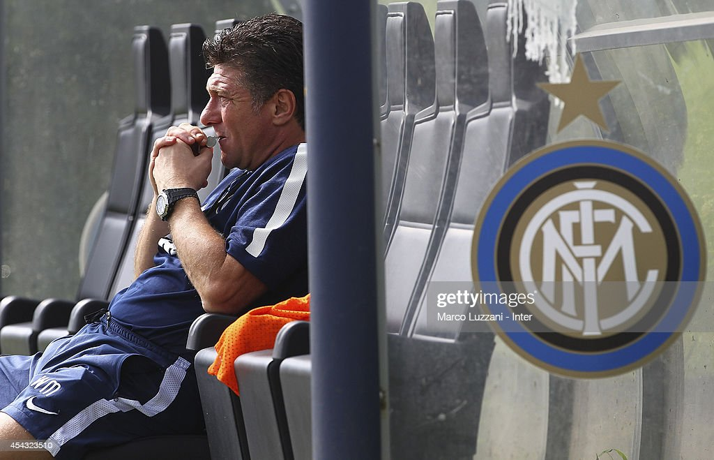FC Internazionale Milano coach <a gi-track='captionPersonalityLinkClicked' href=/galleries/search?phrase=Walter+Mazzarri&family=editorial&specificpeople=5314636 ng-click='$event.stopPropagation()'>Walter Mazzarri</a> looks on during FC Internazionale Training Session at the club's training ground on August 29, 2014 in Appiano Gentile Como, Italy.