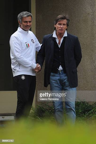 Internazionale Milano head coach Jose Mourinho and Gabriele Oriali attend an FC Internazionale Milano training session during a media open day on May...