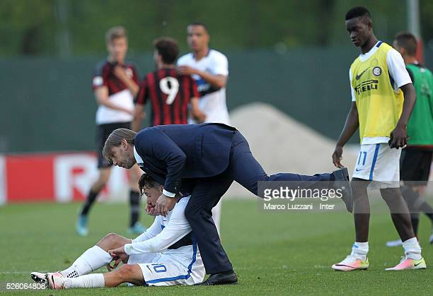 Internazionale Milano Juvenile coach Stefano Vecchi celebrates a victory with his player Enrico Baldini at the end of the juvenile match between AC...