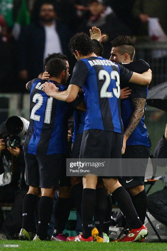 FC Internazionale Milano players celebrate after the first team's goal scored by <a gi-track='captionPersonalityLinkClicked' href=/galleries/search?phrase=Rodrigo+Palacio&family=editorial&specificpeople=490993 ng-click='$event.stopPropagation()'>Rodrigo Palacio</a> during the Serie A match between AS Roma and FC Internazionale Milano at Stadio Olimpico on January 20, 2013 in Rome, Italy.