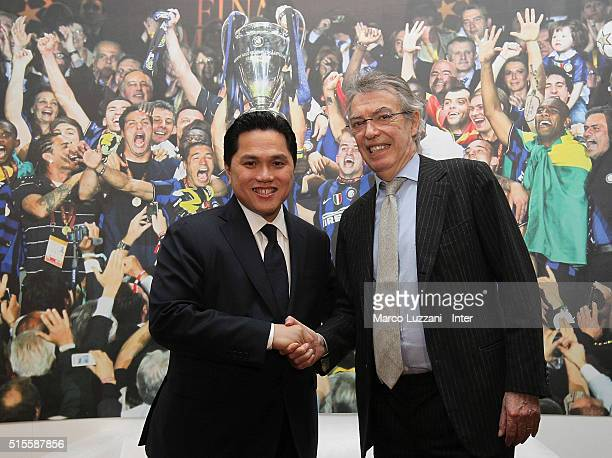 Internazionale Milano president Erick Thohir shakes hands with Massimo Moratti after a press conference at the club's training ground on March 14...