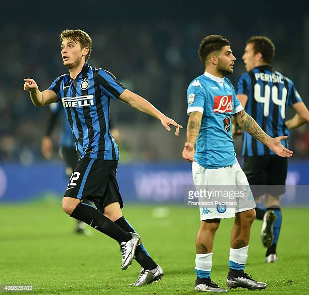 Internazionale Milano's player Adem Ljajic celebrates after scoring the 21 goal beside the disappointment of Lorenzo Insigne player of SSC Napoli...
