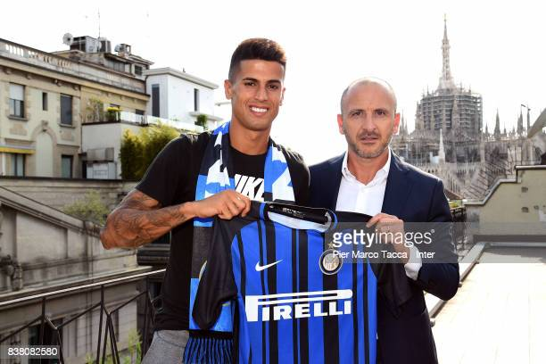 Internazionale New Signing Joao Cancelo and Piero Ausilio pose on August 21 2017 in Milan Italy