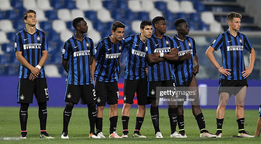 REGGIO NELL'EMILIA, ITALY - MAY FC Internazionale players show their dejection at the end of the juvenile playoff match between FC Internazionale and AS Roma at Mapei Stadium - Citta' del Tricolore on May 31, 2016 in Reggio nell'Emilia, Italy.