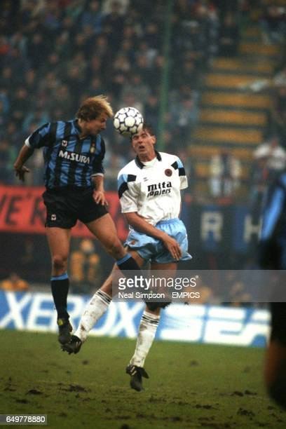 Internazionale's Jurgen Klinsmann and Aston Villa's Kent Nielsen both jump for the ball