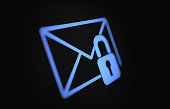 Internet and e mail security concept on lack digital screen. Blue At sign is being protected by  a padlock. Horizontal composition with copy space. Clipping path is included.