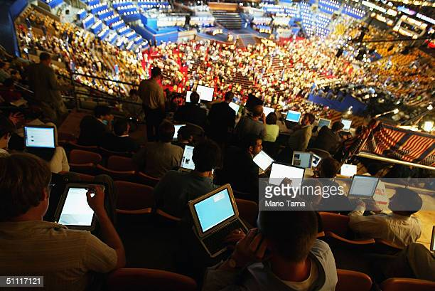 Internet bloggers work on their web log stories during the Democratic National Convention at the FleetCenter July 26 2004 in Boston Massachusetts...