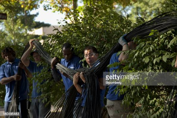 US Internet cabling technicians work in unison to flip fiber optic internet cable during installation in Minneapolis Minnesota US on Thursday Aug 29...