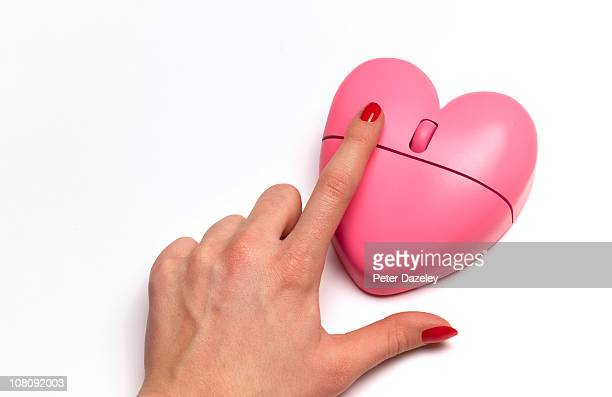 Internet dating heart shaped pink mouse