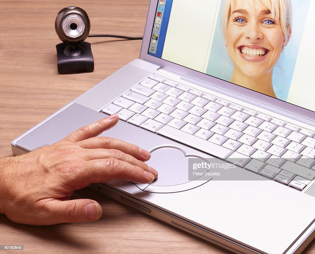 Internet dating on web-cam with girlfriend. : Stock Photo
