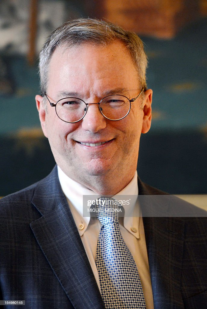 US Internet giant Google executive chairman Eric Schmidt poses during a meeting, on October 29, 2012 at the Ministry of Culture in Paris. Google's executive chairman Schmidt will meet with French President Francois Hollande later in the day, as the Internet giant wrangles with Paris over a bill that would force search engines to pay for content, a government source said on October 27. Google had warned that it would exclude French media sites from its search results if France adopted a bill that would force search engines to pay for content.