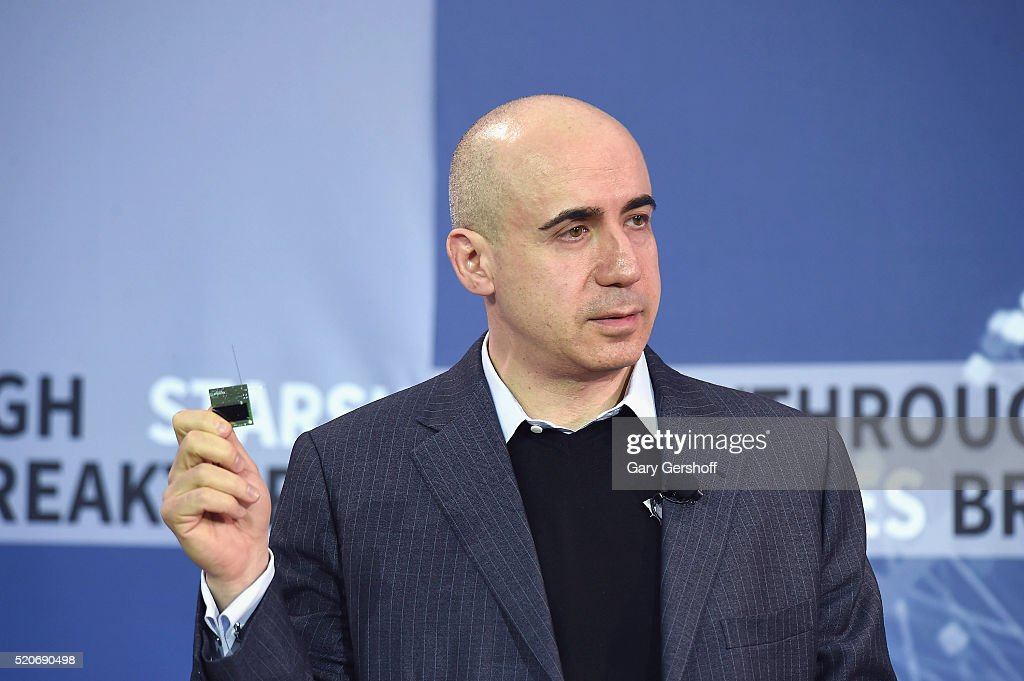 new space exploration initiative internet investor and science philanthropist yuri milner demonstrates the starchip during the new space exploration initiative
