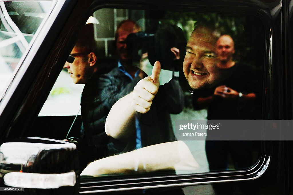Internet MANA founder <a gi-track='captionPersonalityLinkClicked' href=/galleries/search?phrase=Kim+Dotcom&family=editorial&specificpeople=8806663 ng-click='$event.stopPropagation()'>Kim Dotcom</a> departs after casting his advance vote at Liston House on September 3, 2014 in Auckland, New Zealand. The Internet MANA party will go head to head with other parties at the general election on 20 September 2014.