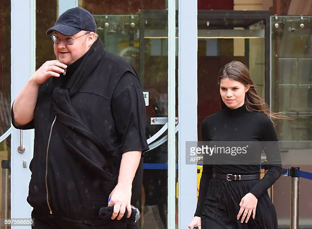 Internet mogul Kim Dotcom leaves with his girlfriend Elizabeth Donelly following his extradition appeal at the High Court in Auckland on August 29...