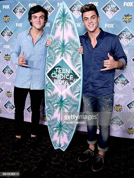 Internet personalities Ethan Dolan and Grayson Dolan pose with the Choice Web Stars award in the press room during Teen Choice Awards 2016 at The...