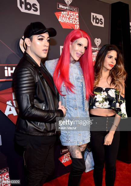 Internet personalities Manny Mua Jeffree Star and Laura Lee attend the 2017 iHeartRadio Music Awards which broadcast live on Turner's TBS TNT and...