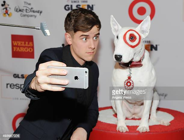 Internet personality Connor Franta poses for a selfie photo with Bullseye the Target dog at the 2015 GLSEN Respect Awards at the Beverly Wilshire...