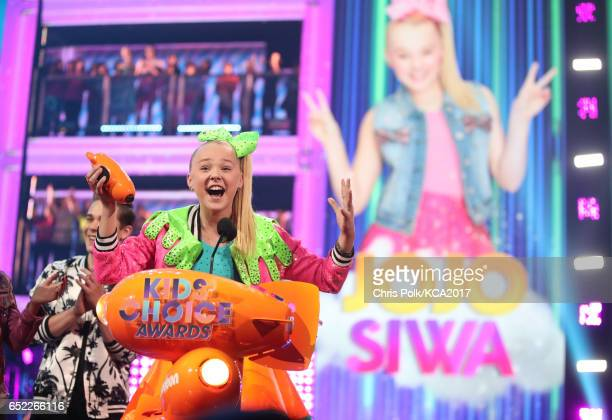 Internet personality JoJo Siwa accepts the award for Favorite Viral Artist at Nickelodeon's 2017 Kids' Choice Awards at USC Galen Center on March 11...