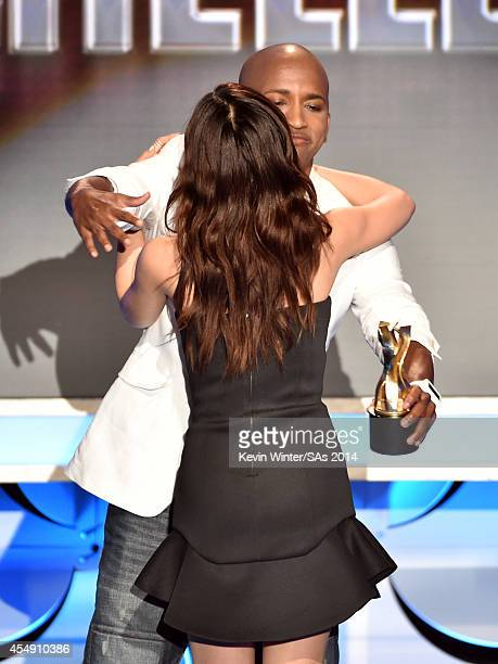 Internet personality Michelle Phan accepts the Icon Award from sWooZie onstage during the 4th Annual Streamy Awards presented by CocaCola on...