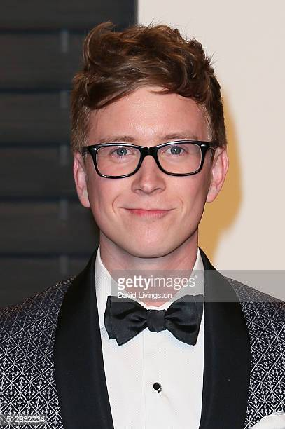 Internet personality Tyler Oakley arrives at the 2016 Vanity Fair Oscar Party Hosted by Graydon Carter at the Wallis Annenberg Center for the...