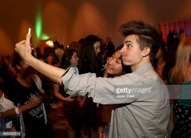 Internet star Chris Collins takes a selfie with a fan at the INTOUR 2014 after party presented by Taco Bell Fullscreens INTOUR at Pasadena Convention...