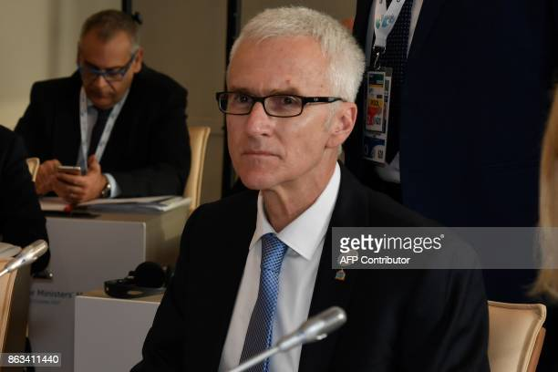 Interpol General secretary Jurgen Stock looks on as he attends before a working session at the G7 summit of Interior Ministers with European Union...