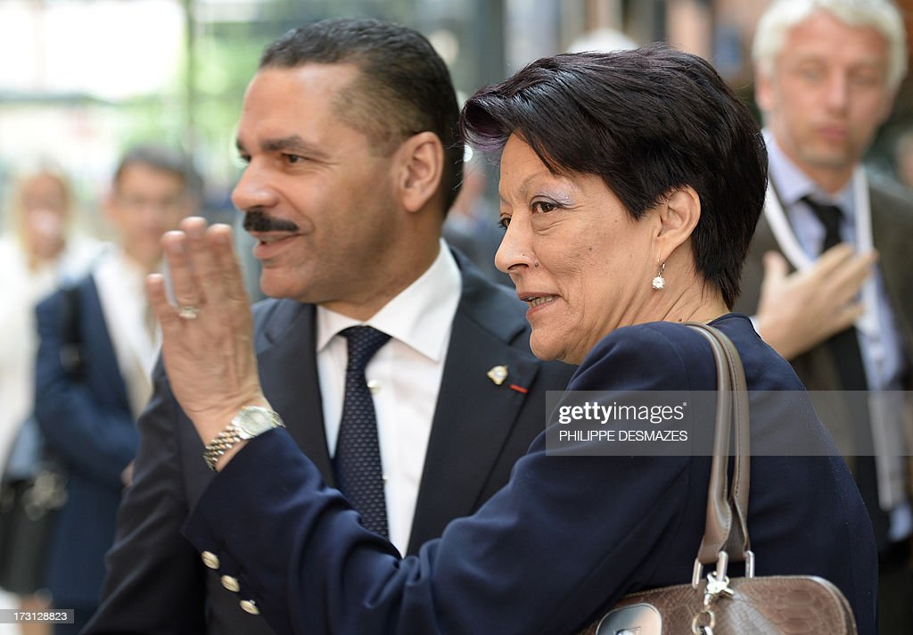 Interpol President Mireille Ballestrazzi (R) and General secretary Ronald K.Noble arrive at the opening plenary session of an Interpol international forum on Technology Against Crime (TAC) on July 8, 2013, in Lyon, southeastern France.