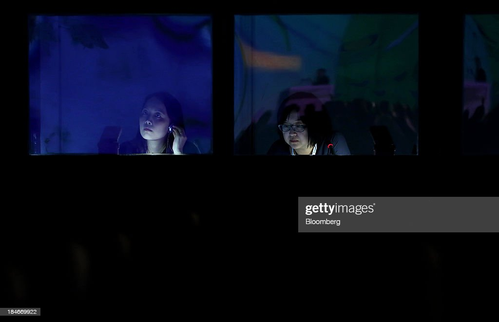 Interpreters work inside a booth during the 22nd World Energy Congress in Daegu South Korea on Tuesday Oct 15 2013 The WEC a global conference on the...